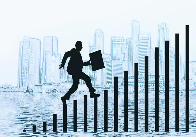 ビジネスマンのシルエットと棒グラフ